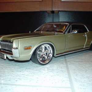 1/18 scale Gold Cougar