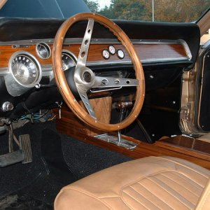 Real walnut everywhere, doors, dash, console, and steering wheel.