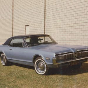 1968 Cougar Standard Coupe --- original owner (my Dad).  So was my first Cougar and still is.  This was taken in 1983 after graduation with around 83-