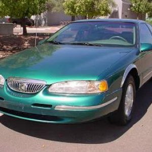 1996 Cougar XR-7,  4.6 Litre V-8, AT, PS, PDB, AC, PW, etc.  Also bought this car in Arizona, from eBay.  Still have this car...is one of the daily dr