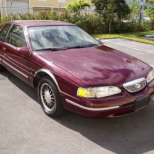 1997 Cougar XR-7 --- 30th Anniversary Special.  (last of the V-8, rear-wheel drive Cougars)! Has the 4.6 Litre V-8, AT, PS, PDB, AC, PW, special anniv