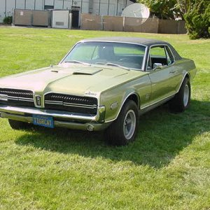 1968 Cougar XR-7 GT-E, 427 with a few mods.  OTC Ford dual-quad intake, headers, and 4.11 gears!  1 of 256 made!