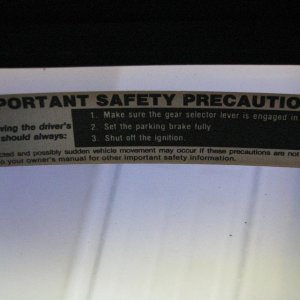 Factory Precaution sticker. Drivers side upper left on windshield.